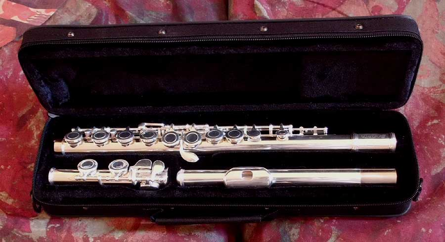 Courante Flute with setup + 1 year complete performance guarantee.